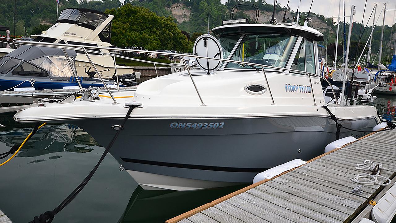 Smaller power boat at dock